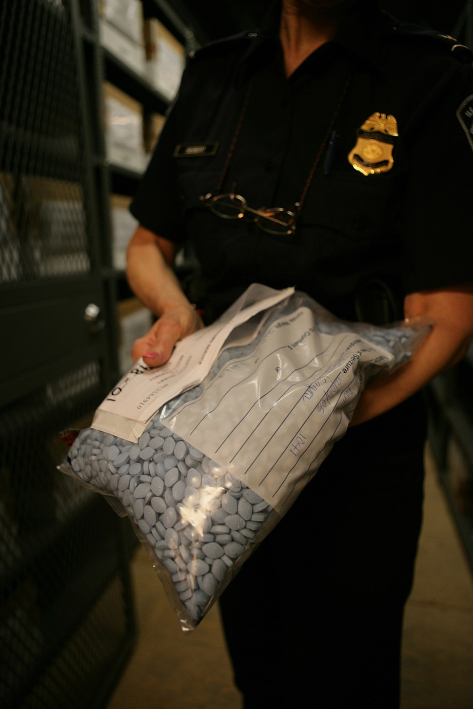 CBP with bag of seized counterfeit Viagra