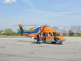 Ornge - An Ornge Sikorsky S-76A C-GIMT (in old livery) preparing to receive a patient at Toronto/Buttonville Municipal Airport.