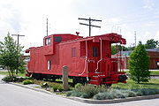 An extended vision caboose on static display in O'Fallon, Illinois.