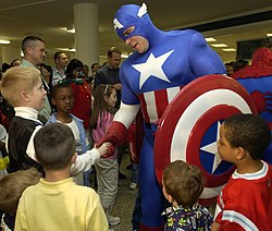Captain America, foreground, and Spiderman greeted many Pentagon-assigned servicemembers and their children on April 28 for the unveiling of a custom comic book for members of the armed services.