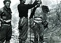 Carleton Coon taking the measurements of a mountaineer in Mirditë (1929).jpg