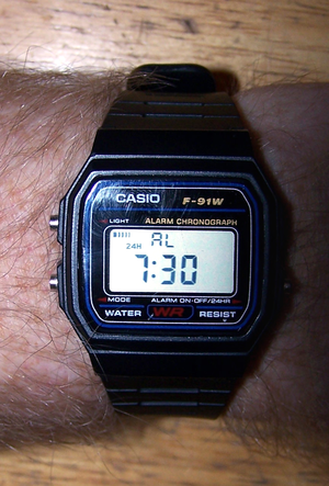 Casio F-91W - Casio F-91W, in daily alarm mode and using the 24-hour display option. The watch is currently set to sound its daily alarm at 7:30 a.m., but hourly beeps are disabled.