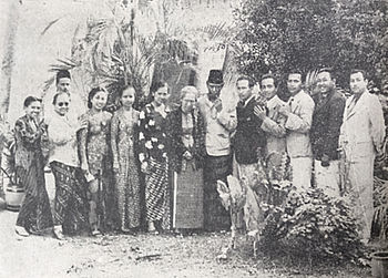 A group photograph of 13 men and women