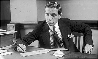 Ponzi scheme - 1920 photo of Charles Ponzi, the namesake of the scheme, while still working as a businessman in his office in Boston