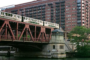 A westbound 'L' train crosses the south branch of the Chicago River.