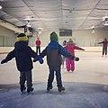 Children learning to skate (16340847790).jpg