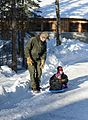 Children ride a sled (12711107543).jpg