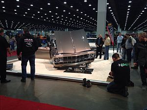 """Detroit Autorama - Designer/Builder Chip Foose stands by his 2015-Ridler Winning '65 Impala (""""Imposter"""") during the first night of the 63rd Annual Detroit Autorama."""