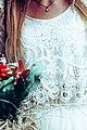 Close-up of a bride with a bouquet (Unsplash).jpg
