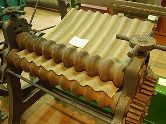 Corrugated galvanised iron - Early manual corrugated iron roller. On display at Kapunda museum, South Australia