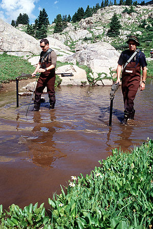 Craig D. Button - Explosive Ordnance Disposal personnel search alpine ponds for any remnants of the four 500-pound Mark 82 bombs