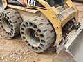 Crocodile Airless Tyres fitted to a Caterpillar Skid Steer Loader.jpg