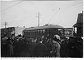 Crowds at Greenwood Ave. wait to board the first streetcar on Gerrard.jpg