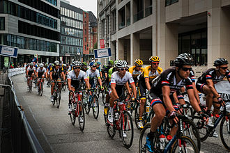 EuroEyes Cyclassics - Peloton at Großer Burstah in Hamburg-Altstadt during the race.