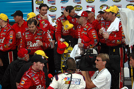 Dale Earnhardt Jr. (bottom), and team in victory lane in 2004 Dale Earnhardt Jr and team in the winners circle photo D Ramey Logan.jpg