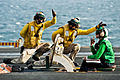 Defense.gov News Photo 111120-N-BT887-071 - U.S. Navy sailors signal the launch of an F A-18F Super Hornet assigned to Strike Fighter Squadron 41 aboard the aircraft carrier USS John C.jpg