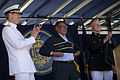 Defense.gov News Photo 120529-D-TT977-662 - Secretary of Defense Leon E. Panetta dons his Naval Academy warm up suit as Naval Academy Superintendent Vice Adm. Michael H. Miller and U.S. Marine.jpg
