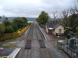 Fota railway station - Disused platform north of the station still with Íarnród Éireann signs and modern benches as of 2011