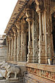 Elephant balustrade and pillars of mantapa in Raghunatha temple in Hampi.JPG