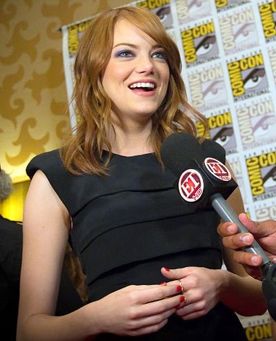 Stone at the 2011 San Diego Comic-Con International. Her hair, eyes, and husky voice have been described as her trademarks by the media. Emma Stone 2011 2.jpg
