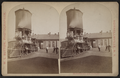 Erie Railroad yard showing locomotive and watertower, by W. L. Sutton.png
