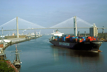 A container ship leaves the Port of Savannah after passing under the Talmadge Memorial Bridge and proceeding down the Savannah River past the Savannah Historic District. Eugene Talmadge Memorial Bridge.jpg