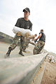 FEMA - 36147 - National Guard off loading sandbags from a truck in Missouri.jpg