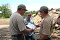 FEMA - 36558 - County employees in Iowa looking over a flood schedule.jpg