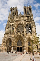 Notre-Dame de Reims facade, gothic stone cathedral against blue sky