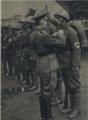 Ferdinand Čatloš decorates ethnic German soldiers in the Slovak army.png