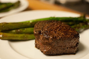 Filet mignon - Traditional filet mignon with grilled asparagus spears