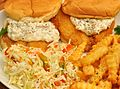 Fish sandwiches with coleslaw and French fries.jpg