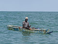 Fisherman with a line on a small boat Gambia.jpg