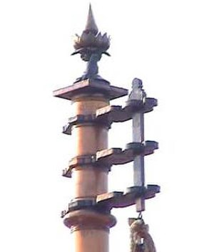 Ayyavazhi ethics - The Flagmast of Swamithoppe with Ayyavazhi symbol at the top