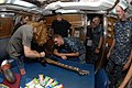 Flickr - Official U.S. Navy Imagery - Sailor watches Dave Mustaine, lead singer of the band Megadeth, autograph his guitar.jpg
