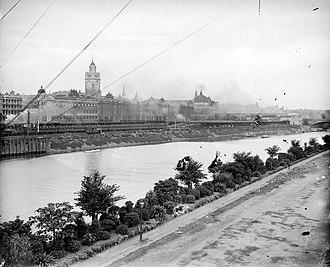 Flinders Street railway station - Looking north across Yarra River towards Flinders Street railway lines and buildings, circa 1914.