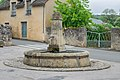 Fountain at Place de l'Eglise in Agen-d'Aveyron.jpg