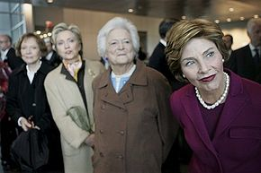 First Lady Laura Bush and former first ladies (from left to right) Rosalynn Carter, Sen. Hillary Clinton and Barbara Bush at the dedication of the William J. Clinton Presidential Center and Park in 2004.