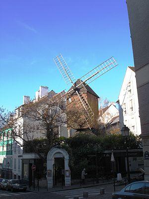 Moulin de la Galette - The present day Moulin de la Galette restaurant topped by the original Moulin Radet.