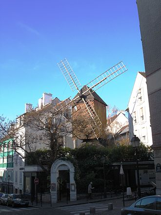 Moulin de la Galette - The present day Moulin de la Galette restaurant topped by the original Moulin Radet.