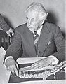 Frank Lloyd Wright with Crystal Heights plan.jpg