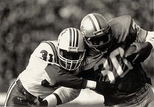 Fred Marion - Marion (left) playing for the Patriots in 1985