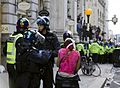 G20 injured protester and police.jpg