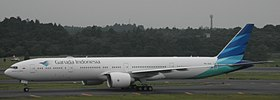 Garuda Indonesia B777-3U3ER (PK-GIA) taxiing at Narita International Airport.jpg