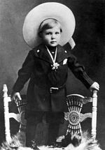Photo of Gary Cooper dressed as a cowboy at the age of two