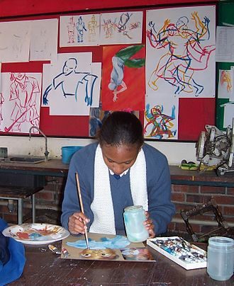 Education in Zimbabwe - A student works on a school project at Gateway High School in Zimbabwe.