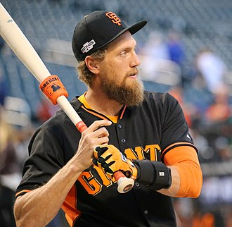 "Baseball doughnut - Hunter Pence using a ""Hitting Jack-It"" weight, a doughnut which allows a player to take batting practice while using it."