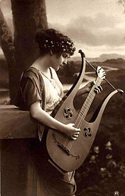 A painting depicting a girl with a lyre-guitar] with a lyre-guitar.