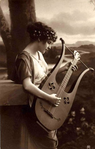 Lyre-guitar - A postcard showing a girl playing a lyre-guitar. The classical theme is typical of the period.