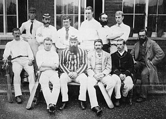 W. G. Grace - Gloucestershire County Cricket Club in 1880 shortly before Fred Grace's untimely death. W. G. Grace is seated front left centre. Fred (hooped cap) is third left in rear group. Billy Midwinter (directly behind W. G.) is fourth left in rear. E. M. Grace (bearded) is sixth left in rear.